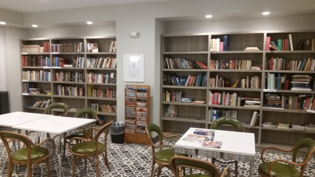 The new library on the South Building. A very short low key campaign resulted in my books donated. The furniture is composed from chairs and tables that once were used in the Aquarius restaurant. When we find funds they will be replaced.
