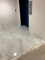 Service elevator landing with porcelain tiles.
