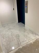 Service elevator landing with porcelain tiles.